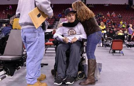 Diane Malafronte helped her son out of his wheelchair.